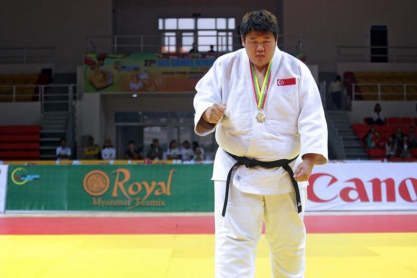 Singapore's Ho Han Boon wins gold in men's judo +100kg category during the 27th SEA Games in Naypyidaw's Zayar Thiri Indoor Stadium, Myanmar,on Saturday, Dec 21, 2013. -- ST PHOTO: KEVIN LIM