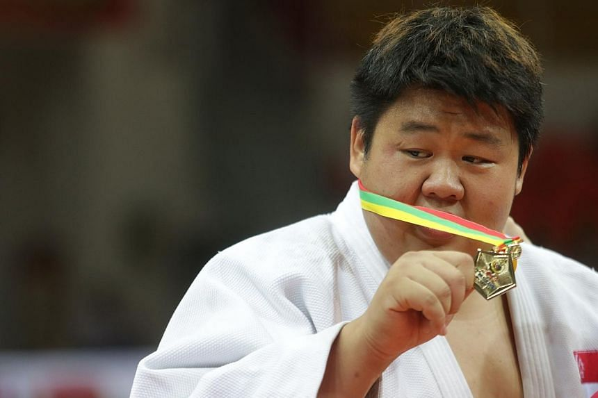 Singapore's Ho Han Boon wins gold in men's judo +100kg category during the 27th SEA Games in Naypyidaw's Zayar Thiri Indoor Stadium, Myanmar, on Saturday, Dec 21, 2013. -- ST PHOTO: KEVIN LIM