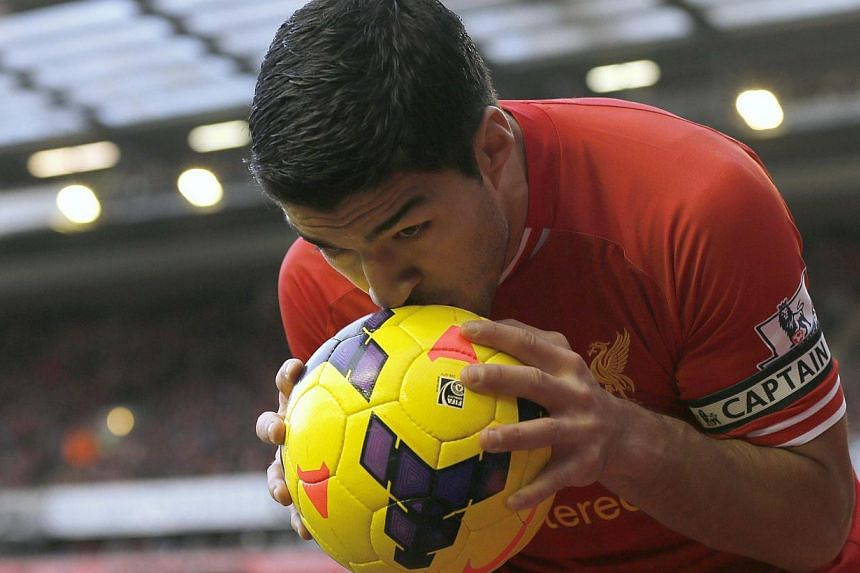 Liverpool's Luis Suarez during theEnglish Premier League match against Cardiff City at Anfield in Liverpool, on Saturday, December 21, 2013.Suarez celebrated his new contract by scoring twice in a 3-1 win over Cardiff City that sent Liverpool t