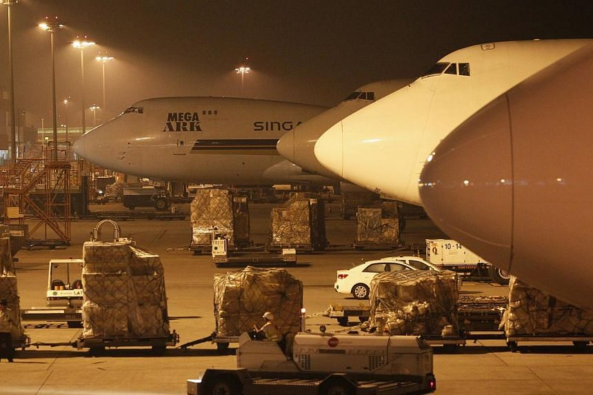 Singapore Airlines cargo planes at the Changi Aiport Cargo Terminal, on May 29, 2013.The cargo arm of Singapore Airlines (SIA) has agreed to settle over the issue of price fixing in the United States, without admitting to any wrongdoing or liab