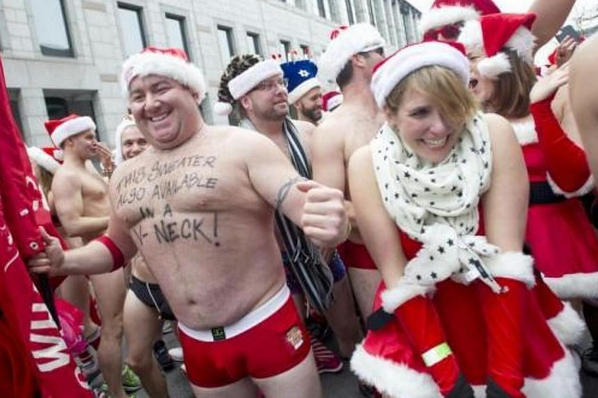 Runners gather at the start line for the annual Santa Speedo Run, a charity race through the streets of the Back Bay neighbourhood of Boston, Massachusetts, on Dec 14, 2013.-- FILE PHOTO: REUTERS