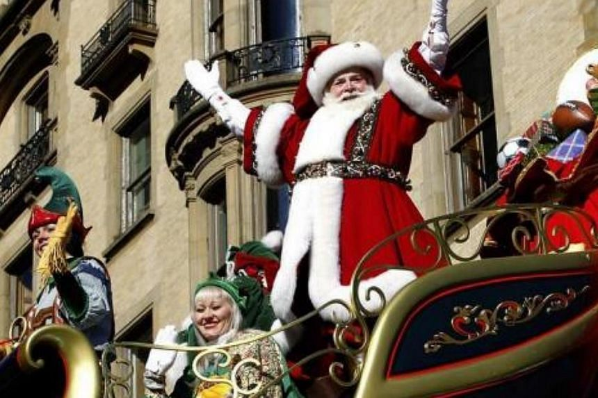 Santa Claus waves as he rides on his float down Central Park West during the 87th Macy's Thanksgiving Day Parade in New York, on Nov 28, 2013.-- FILE PHOTO: REUTERS