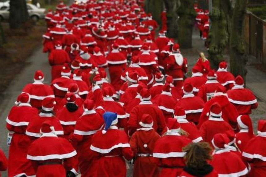Competitors dressed up as Father Christmas run in the 10km so-called Nikolaus Run (Santa Claus Run) in the east German town of Michendorf, some 40km south-west of Berlin, on Dec 8, 2013.-- FILE PHOTO: REUTERS