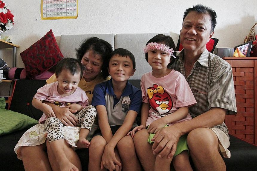 Mr Goh with Ms Dariyah and their children (from left) daughter Zharfitri, son Zharfan and daughter Zharfy. Ms Dariyah is his second wife. They met in Jakarta in 2000, and he got a divorce to marry her.