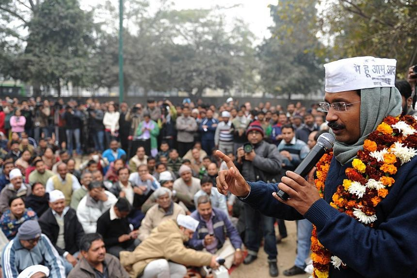 """India's Aam Aadmi Party (Common Man's Party) leader Arvind Kejriwal gestures as he addresses a public meeting in New Delhi on December 22, 2013. Mr Kejriwal, an anti-graft crusader, has vowed to punish corrupt ministers and clean up """"dirty politics"""""""