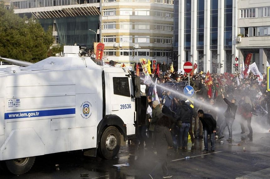 Police fired water cannon and teargas at protesters marching in Istanbul on Sunday against the Turkish government's urbanisation plans and a corruption investigation in which scores of people, including the sons of ministers, have been arrested. -- P
