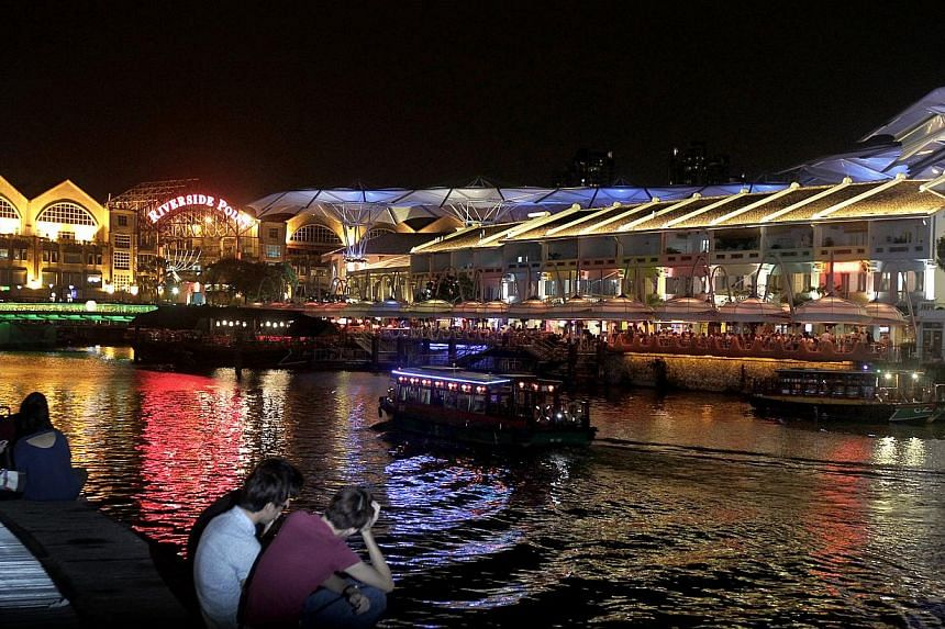 (Above) A view of Clarke Quay during the Christmas by the River festival. (Below) Some retailers say they hope to see more activities.
