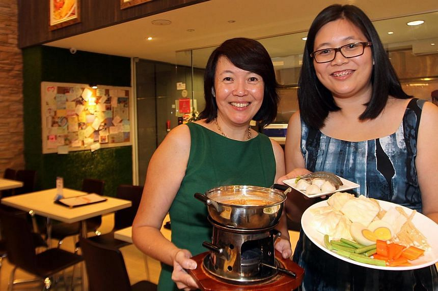 Madam Sim (left) and Ms Tay at the Bugis+ outlet of Laksania. They have offered Groupon promotions this month.