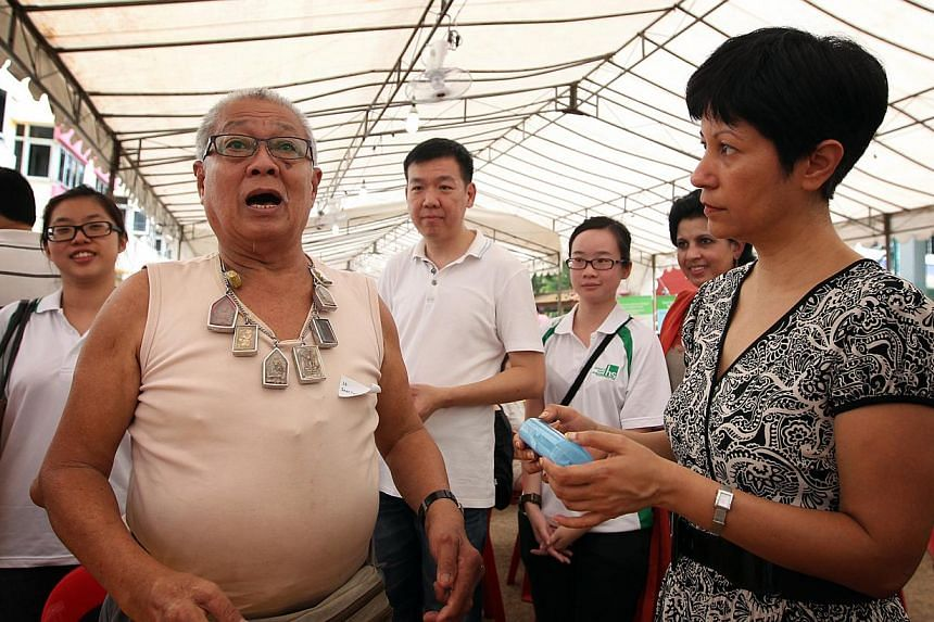 Christmas came early for Mr Seet Teck Lim, 67, who's happy with his new spectacles, presented to him by MP for Tanjong Pagar GRC Indranee Rajah, who is also Senior Minister of State (Law and Education), at Jalan Bukit Merah yesterday.