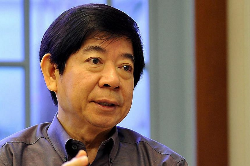 """The Government cannot """"eliminate"""" the property cycle, but it """"can try to keep bubbles less bubbly"""", National Development Minister Khaw Boon Wan (above) wrote in a Facebook post on Monday, Dec 23, 2013. -- ST FILE PHOTO:JOYCE FANG"""