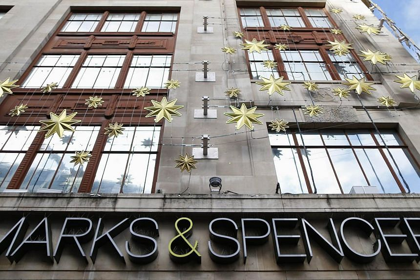 Christmas decorations adorn the exterior of retailer Marks and Spencer's flagship store in London's West End on Nov 5, 2013.British retailer Marks & Spencer faced criticism on Monday, Dec 23, 2013, after it emerged that it allows Muslim sta
