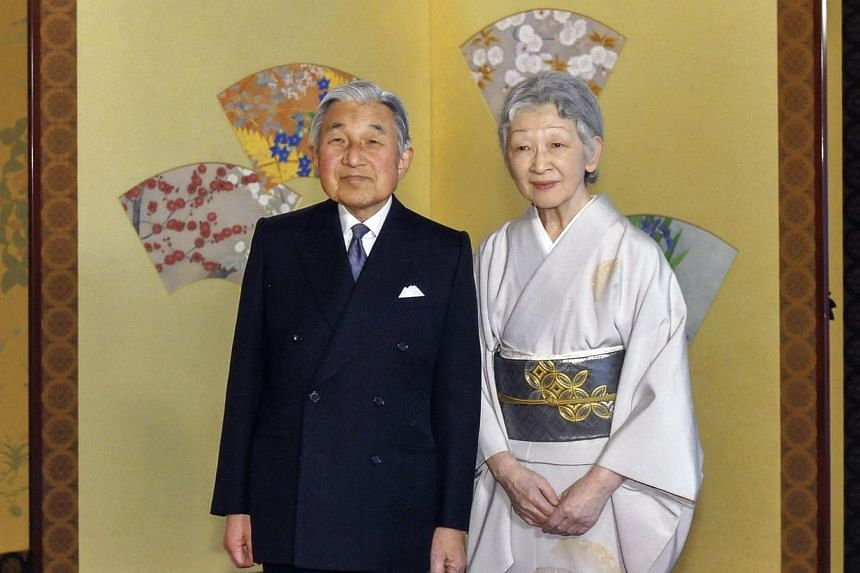 This handout photo taken on Nov 14, 2013, and released on Monday, Dec 23, 2013, by the Imperial Household Agency of Japan shows Emperor Akihito (left) and Empress Michiko posing at the Imperial Palace in Tokyo.Thousands of people thronged Japan