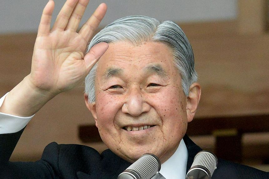 Japanese Emperor Akihito waves to well-wishers celebrating his birthday at the Imperial Palace in Tokyo on Monday, Dec 23, 2013. -- PHOTO: AFP