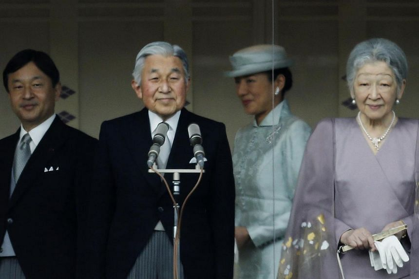 (From left) Japan's Crown Prince Naruhito, Emperor Akihito, Crown Princess Masako and Empress Michiko stand in front of well-wishers who gathered to celebrate the monarch's 80th birthday at the Imperial Palace in Tokyo on Monday, Dec 23, 2013. -- PHO