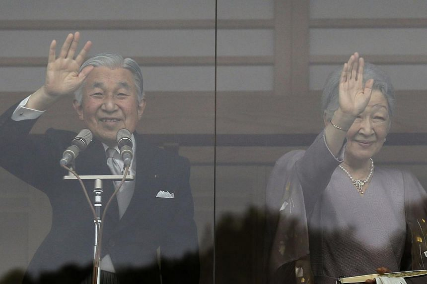 Japan's Emperor Akihito (left) and Empress Michiko wave to well-wishers who gathered to celebrate the monarch's 80th birthday at the Imperial Palace in Tokyo on Monday, Dec 23, 2013. -- PHOTO: REUTERS