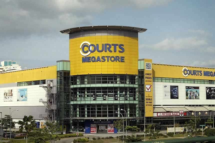 Furniture and electronics retail giant Courts will be donating $1 from every customer transaction on Christmas Day to The Straits Times School Pocket Money Fund (SPMF). -- ST FILE PHOTO: KEVIN LIM