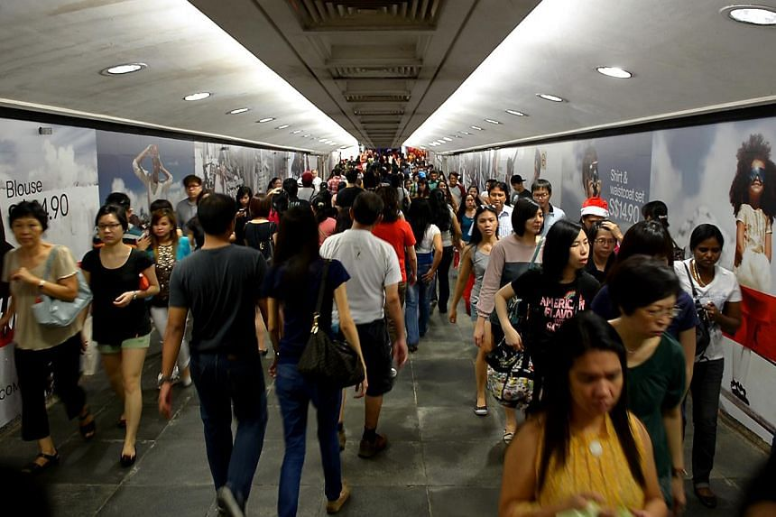 The crowd at the underpass which links Orchard MRT station with Tangs before Christmas on Dec 23, 2012.Four people were injured at an escalator in Orchard MRT station on Monday evening, Dec 23, 2013.-- ST FILE PHOTO:KUA CHEE SIONG