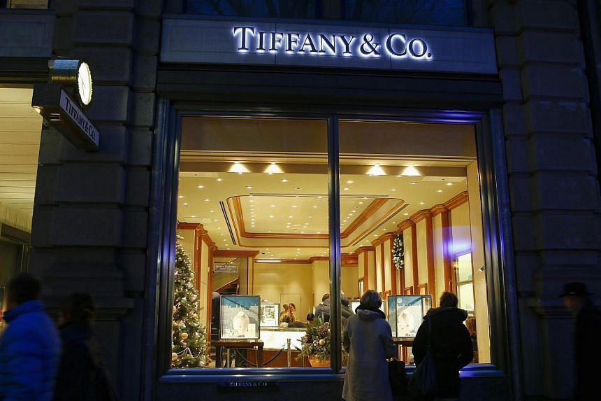 People stand in front of a Tiffany store on Bahnhofstrasse shopping street in Zurich on Dec 19, 2013.Swatch Group said a Dutch court has sentenced Tiffany & Co. to pay it 402 million Swiss francs (S$567 million) in damages in a lawsuit foll