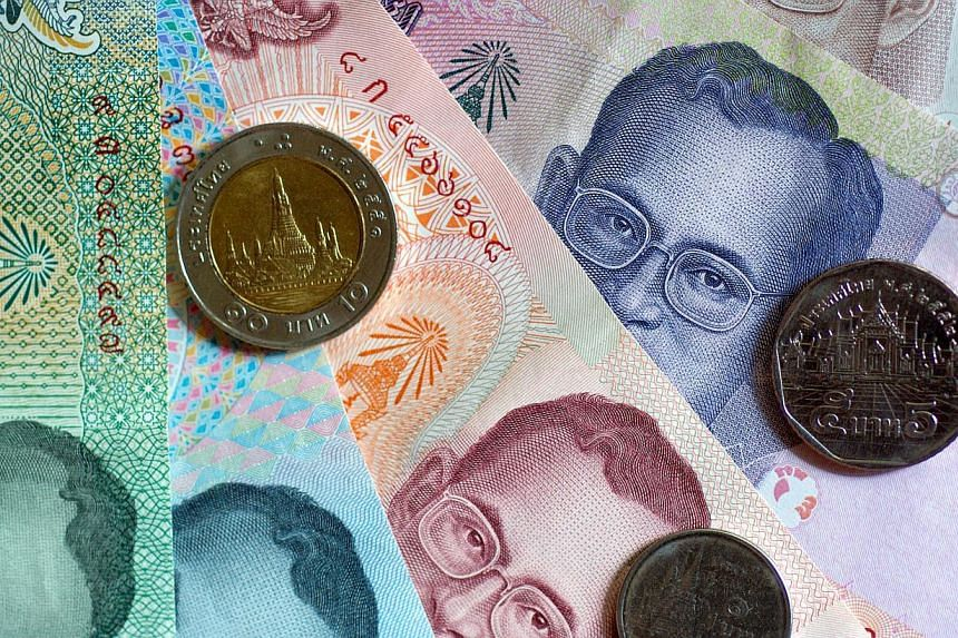 The Thai baht slumped to its lowest level in almost four years against the dollar on Monday, hurt by deepening political turmoil after Thailand's main opposition party said it would boycott an election in February. -- FILE PHOTO: BLOOMBERG