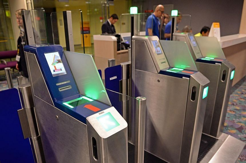 New self-service machines that are on trial at Changi Airport's Terminal 2 are letting travellers breeze through the boarding gates in under three seconds. -- ST PHOTO: RAJ NADARAJAN