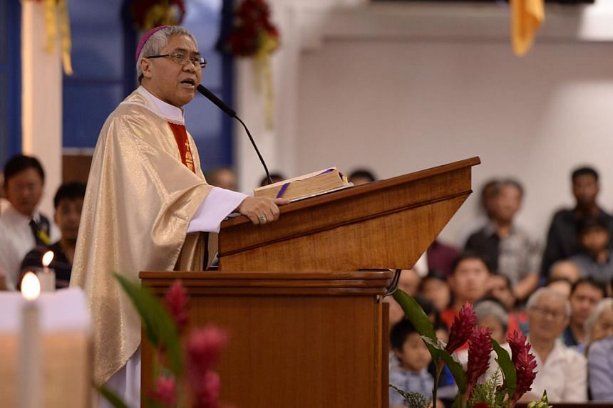 Archbishop William Goh of the Catholic Church delivering a Christmas homily at a Christmas mass at the St Anne's Church in Sengkang on Tuesday, Dec 24, 2013. -- ST PHOTO: RAJ NADARAJAN