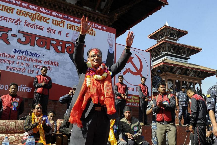 Unified Communist Party of Nepal (Maoist) chairman Pushpa Kamal Dahal, also known as 'Prachanda', waves to supporters during an election campaign rally in Kathmandu on Nov 15, 2013.Nepal's Maoists have agreed to join the country's constituent a
