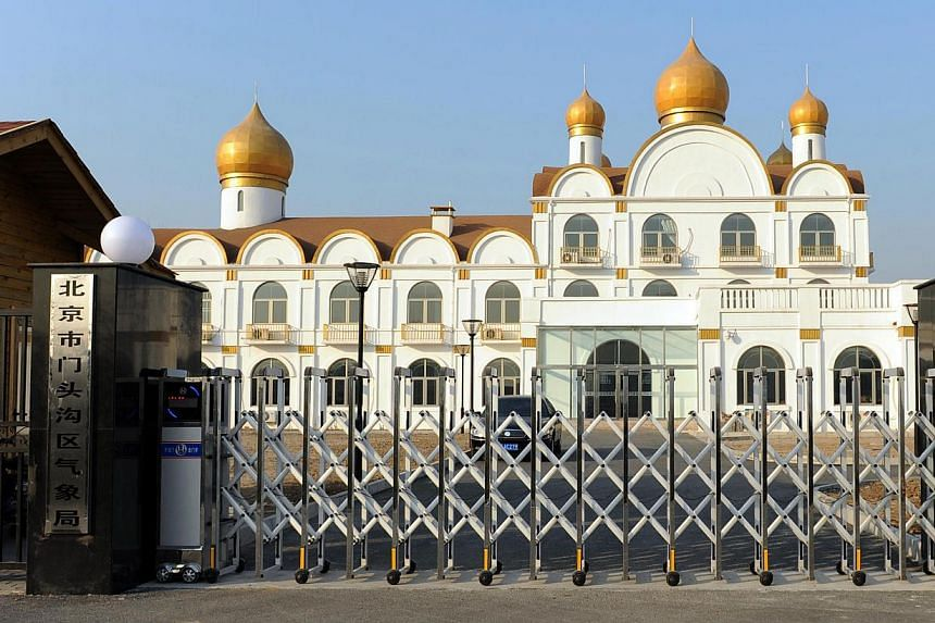 This picture taken on Monday, Dec 23, 2013, shows an office complex resembling Moscow's Kremlin in the western Beijing suburb of Mentougou.Local officials in a Beijing suburb have built themselves a white-walled, gold-domed office complex resem