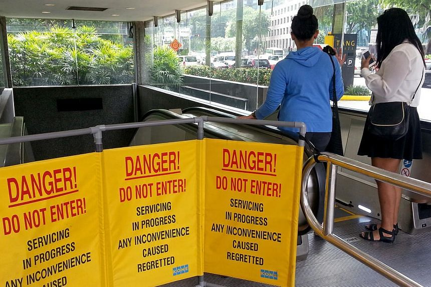 Anincident at Orchard MRT station on Monday, Dec 23, 2013, that injured four people was caused by an escalator they were on suddenly halting, sending them falling. -- ST PHOTO:JACQUELINE CHANG