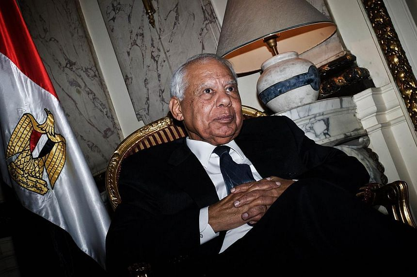 "Egypt's interim prime minister Hazem Beblawi gives an interview to a journalist from the Agence France-Presse at his office in Cairo on Nov 24, 2013. Mr Hazem Beblawi has declared the country's Muslim Brotherhood movement a ""terrorist"" organisat"