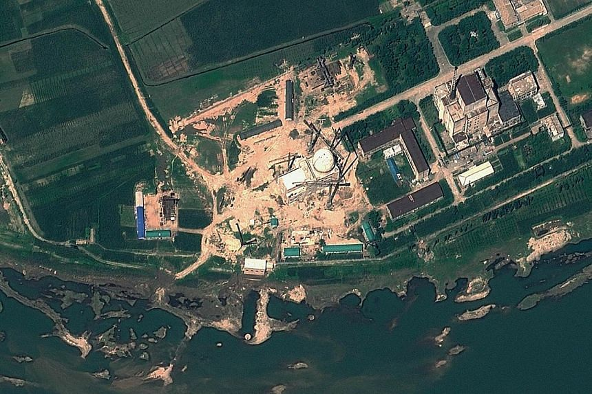 "This file satellite image taken on Aug 6, 2012 and provided by GeoEye on Aug 22, 2012 shows the Yongbyon Nuclear Scientific Research Centre in North Korea. Satellite imagery suggests North Korea is making ""wide-ranging, extensive"" efforts to fully re"