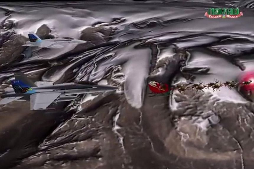 Santa's sled is escorted by a pair of fighter jets in this still image taken from an handout Norad animated video released on Nov 27, 2013.Santa Claus was officially cleared for entry into the United States (US) on Monday as federal agriculture