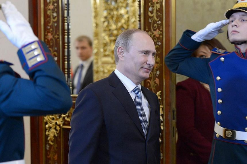 Russian President Vladimir Putin arrives for a meeting of the Supreme Eurasian Economic Council, at the Kremlin in Moscow, on Tuesday, Dec 24, 2013. Putin said on Tuesday that the final pieces were in place for the 2015 launch of an economi