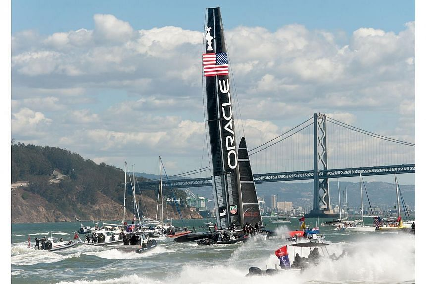 Fleet and spectator boats follow Oracle Team USA as it celebrates its victory over Emirates Team New Zealand in the 34th America's Cup on Sept 25, 2013, in San Francisco. Oracle Team USA wants to stage the next America's Cup regatta in San Francisco