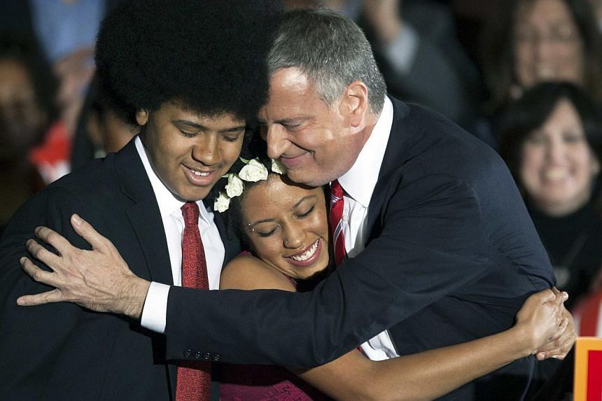 Democratic mayor-elect of New York, Bill de Blasio, hugs his daughter Chiara and son Dante during his election victory party at the Park Slope Armory in New York, Nov 5, 2013. Chiara De Blasio released a video Dec 24, 2013 in which she discusses her