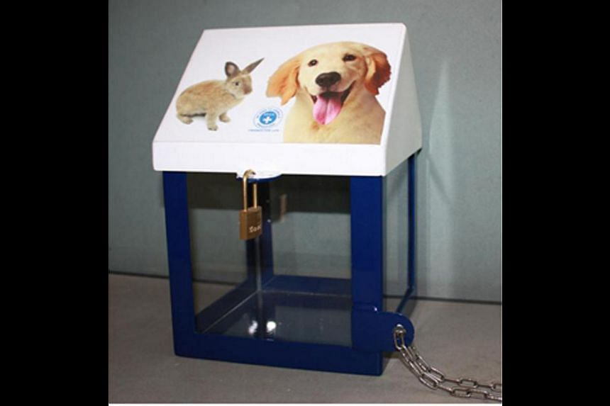 The SPCA introduced its new house-shaped donation box two years ago, to suit counter-tops at supermarket chains. -- PHOTOS: CEREBRAL PALSY ALLIANCE SINGAPORE, ST FILE, SPCA