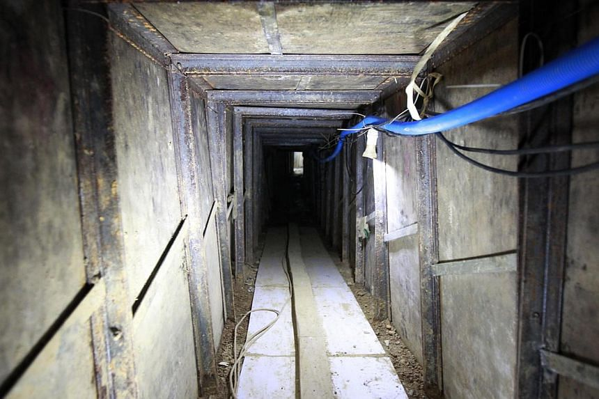 """A tunnel which was built by smugglers is seen near the border of Hong Kong, in Changling village of Shenzhen, Guangdong province on Tuesday, Dec 24, 2013.Chinese smugglers dug a """"professional"""" concrete tunnel into Hong Kong equipped with lights"""