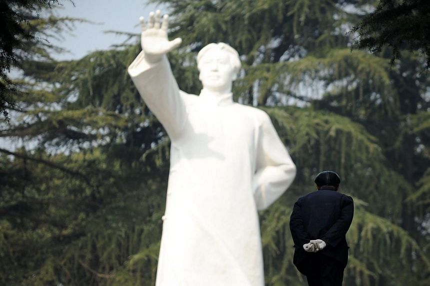 An elderly man walks to a statue of former Chinese leader Mao Zedong at a park in Shaoshan, in China's central province of Hunan on Wednesday, Dec 25, 2013. Thousands of admirers of Communist China's founder Mao Zedong flocked to his home town o