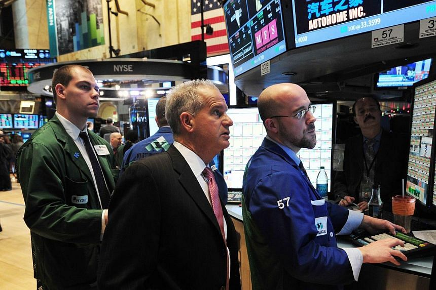 Traders work on the floor of the New York Stock Exchange on Dec 24, 2013 in New York. United States (US) stocks scored modest gains on Tuesday as investors exercised restraint from making big bets in a short session ahead of the Christmas holiday, wi