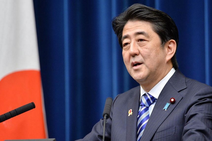 Japanese Prime Minister Shinzo Abe delivers a speech during a press conference at the Abe's official residence Tokyo on Dec 14, 2013. Mr Abe is to pray at the controversial Yasukuni war shrine in central Tokyo today, according to Japanese media repor