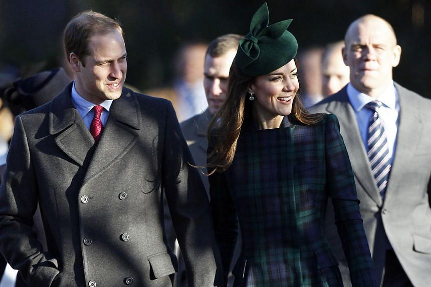 Britain's Prince William (left) and his wife Catherine, Duchess of Cambridge, arrive for a traditional Christmas Day Church Service at Sandringham in eastern England, on Dec 25, 2013.  Prince William and his wife Catherine left their baby son Pr