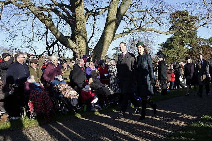 Britain's Prince William (centre, left) and his wife Catherine, Duchess of Cambridge, arrive for a traditional Christmas Day Church Service at Sandringham in eastern England, on Dec 25, 2013.  Hile most people in Britain open their presents on C