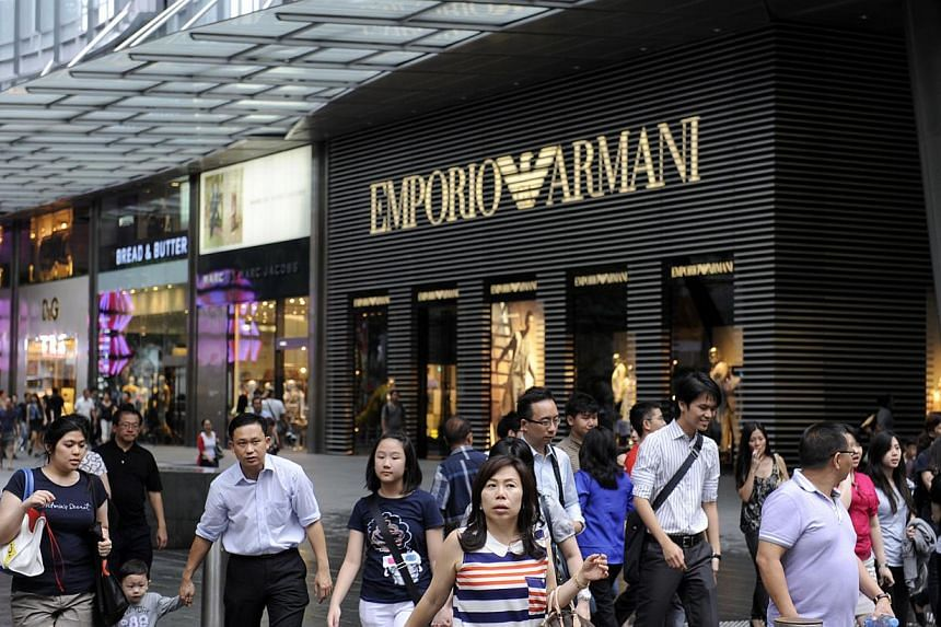 Shoppers in front of Mandarin Gallery along Orchard Road on Jan 9, 2012. The gap between retail rents in Orchard Road and suburban regional centres continued to narrow this year, as tenants opt to set up shop farther out from the city centre. --