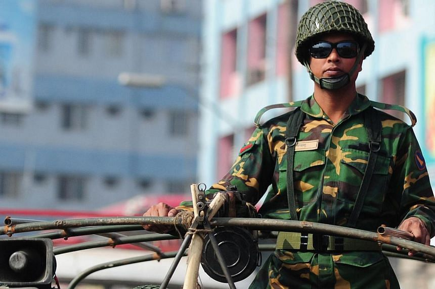 A Bangladeshi soldier looks on from a patrolling truck during an ongoing blockade organised by the main opposition Bangladesh Nationalist Party (BNP) and its Islamist allies in Dhaka on Dec 24, 2013. Tens of thousands of troops were to be deploy