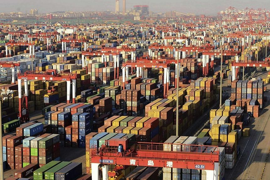 Shipping containers are seen piled up at a port in Qingdao, Shandong province on Dec 10, 2013.China's economic growth is likely to come in at 7.6 percent this year, down slightly from 7.7 percent in 2012, the official Xinhua news agency quoted