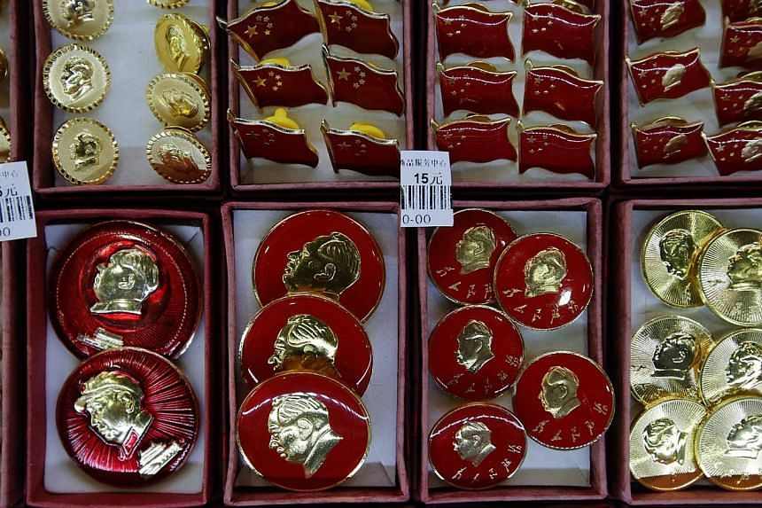 Pins bearing images of China's late Chairman Mao Zedong are displayed at a souvenir shop in Beijing, on Nov 25, 2013.China celebrates the 120th birthday of Mao Zedong, the founder of modern China, on Thursday, but will be scaling back festiviti