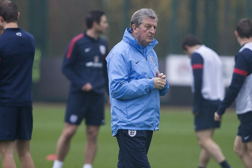 Manager of the England football team Roy Hodgson gestures to players during an England training session at Arsenal's training ground, London Colney, north of London on Nov 18, 2013.Roy Hodgson has been so impressed by the form of his young play