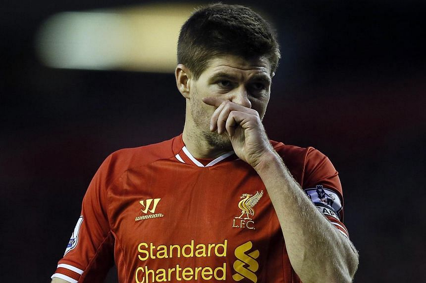 Liverpool's Steven Gerrard wipes his face during their English Premier League soccer match against West Ham United at Anfield in Liverpool, northern England on Dec 7, 2013. Gerrard has played down talk of a first Premier League title in almost a