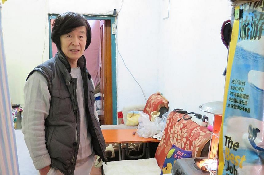 Mr Sun Jiake lives with his wife in a single-storey, approximately 23 sq m brick unit in Huashiying village in Beijing. They hope the government will demolish the area and give them an affordable new home. -- PHOTO: ESTHER TEO