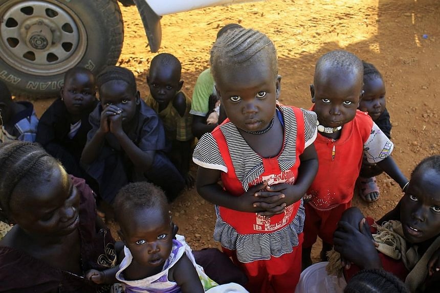 Newly arrived displaced families wait at Tomping United Nations base near Juba international airport, where some 12,000 people from the Nuer tribe have sought refuge at, on Dec 24, 2013.Aid agencies need US$166 million (S$210 million) over the