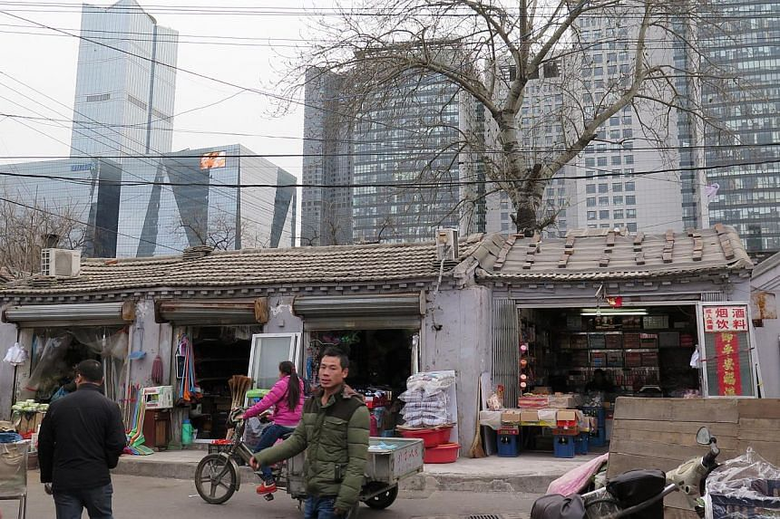 An urban village in the heart of Beijing standing out against the modern skyscrapers in the background. -- PHOTO: ESTHER TEO